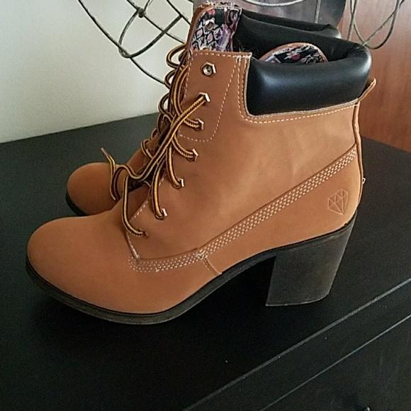 9427bcb37a0 High heel boots look like workbooks